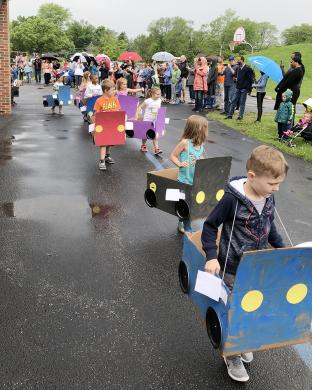 A few rain drops couldn't stop the parade as kindergarteners showed off their handiwork to parents and supporters.