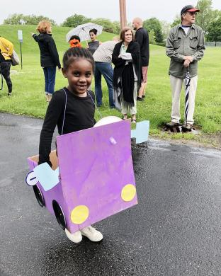 Kindergartener Toni Richardson chose a bright purple for her car in the Box Car Parade.