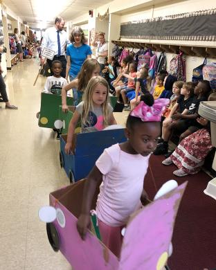 After an outdoor parade, kindergarteners brought their Box Car Parade indoors to show off their handiwork to fellow Willow School students.