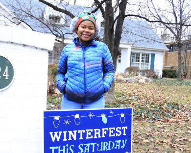 Sanaa Harris, a Parker Junior High student, poses in front of Janet Gustafson's home, where people were invited to tour the elaborate gingerbread village she creates annually for the holidays. Harris and her partner, Ucheoma Onwuezyi (not pictured) were guides who escorted festival goers to the Gustafson residence. Discussion