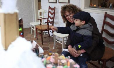 Jack Bollenbacher points at the Janet Gustafson's gingerbread scene, indicating a point of interest to his grandmother, Mary Ellen Bollenbacher.