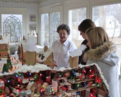 Janet Gustafson talks to a visitor about her locally famous gingerbread village.