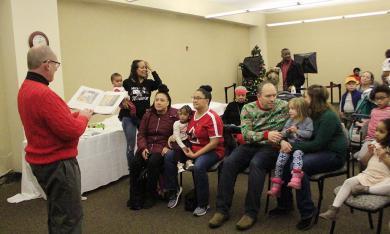 """Flossmoor Mayor Paul Braun reads """"How Santa Got His Job"""" by Stephen Krensky during Winterfest."""