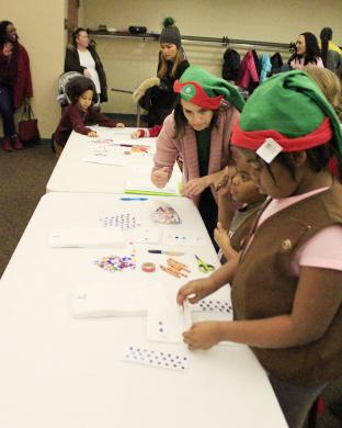 Girl Scouts make holiday crafts in the lower level of Flossmoor Public Library during Winterfest.