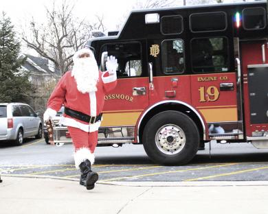 Santa Claus arrives at Flossmoor Library to consult with youngsters about their Christmas wishes.