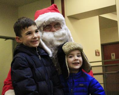 Conor, left, and Caleb Gochenour were the first children to greet Santa at Flossmoor Public Library.