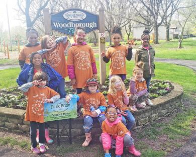 It was all smiles for a job well done by Girl Scout Troop 65452. Troop leader Ashley Raske volunteered the girls to clean up in Woodborough Park, 184th and Aberdeen in Homewood. (Provided)