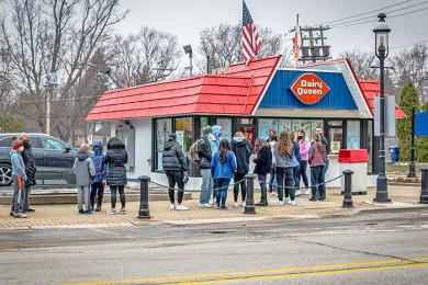 Patrons wait outside the Homewood Dairy Queen on opening day March 17 for a free cone of soft serve. (ABS)