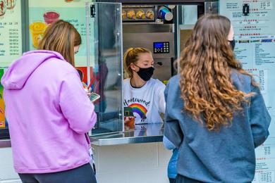 Natalie Calderone serves customers at the Homewood Dairy Queen on opening day. (ABS)