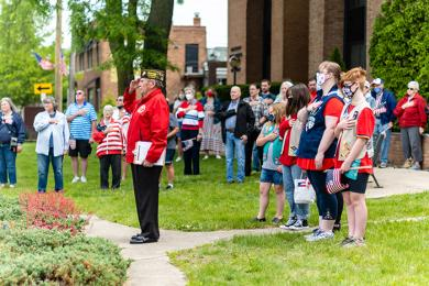 Girl Scout Troop 60523, standing right, led the community in the Pledge of Allegiance during the Homewood ceremony. (ABS)