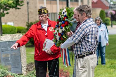 Dale Mitchell congratulates staffers Melanie Mandisodza and Scott McAlister upon earning PhD degrees in 2017. (Chronicle file photo)John Beele, commander of the Wally Burns VFW Post 8077 directs  veterans of the Vietnam War on where to display a wreath dedicated to the fallen. (ABS)