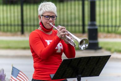 Sarah Whitlock, the director of the Homewood-Flossmoor marching band, performed with the musicians. (ABS)