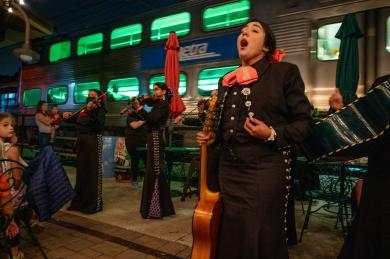 Imagine getting off a train and finding you're part of the stage set by the Mariachi Sirenas! band. The performers entertained in downtown Flossmoor on Wednesday, Oct. 6. (ABS)