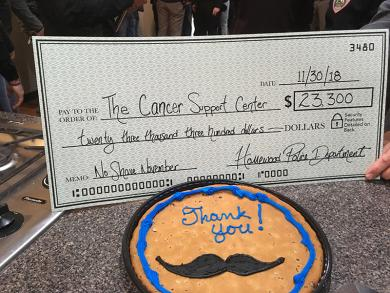 Cancer Support Center hosted a small reception for Homewood police officers who raised money.