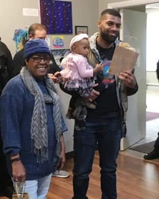 Homewood police officer E.J. Dorsey, holding his 1-year-old daughter, Piper, won Best Beard in a contest judged in part by Cancer Support Center volunteer Dorothy.
