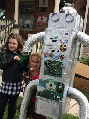 Brownies Teagan Meeks, at left, and Linnea Brattstrom, both 8, stand before their Tin Mint robot created by Girl Scout Troop 65113. It took the People's Choice Award in Homewood's annual scarecrow contest.