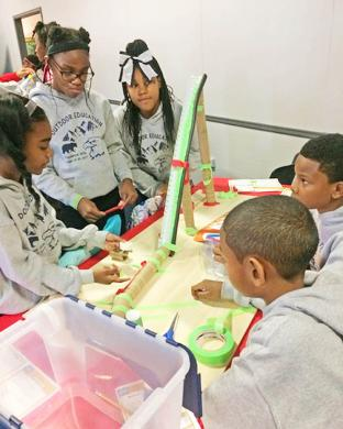 This Flossmoor Hills School fifth grade team of, from left, Nevani Bell, Mary-Kathleen Stalling, Emoni Brown, Cameron Brooks and Jovohn Ratliff uses imagination to build a roller coaster. (MT)