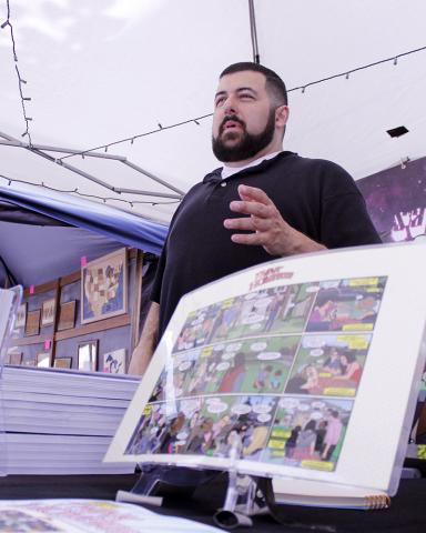 Marc Alan Fishman, illustrator for the comic-based Think Homewood marketing materials discusses a poster version he created to be sold at the street fair.