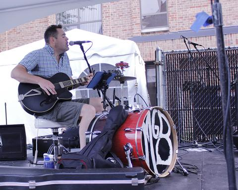 MG Bailey performs blues/rock covers and original songs during the first set at the Artisan Street Fair.