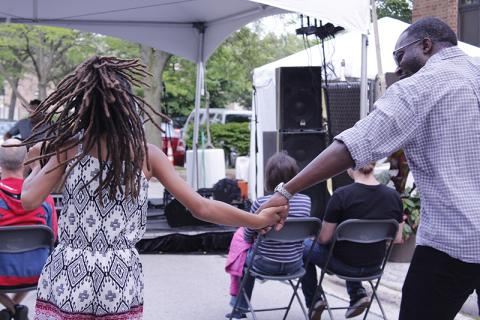 Alyssa Bobb, left, dances with her dad, Ian Bobb, while listening to MG Bailey perform.