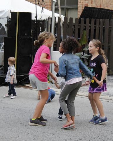 Youngsters form a dancing circle during The Hemispheres evening set.