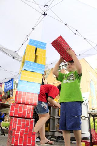 Jackson Symowicz builds a tower in the play area for young children.
