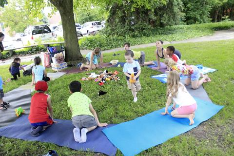 Liz Smith leads a session of yoga for kids.