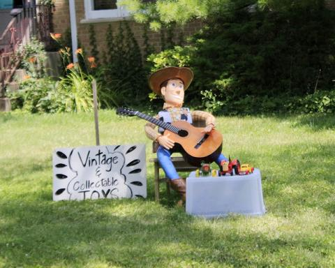 "Sights along the way: Woody from ""Toy Story"" helps advertise a yard sale."