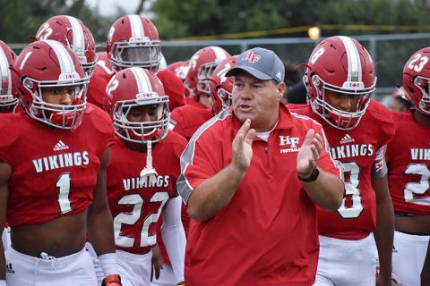 Vikings' Coach Craig Buzea cheers on the team during the homecoming game on Friday night.