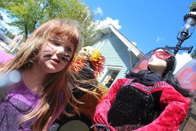 Gabriella Siegmeyer introduces her scarecrow, Madame Murderfly