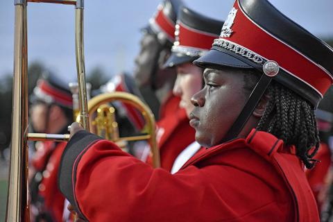 H-F High Marching Band member Abeni Lane prepares to perform with other band members during the homecoming game.