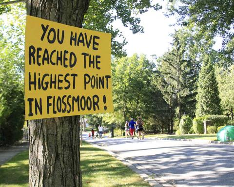 A sign greets runners who have just scaled the hill on Braeburn Avenue.