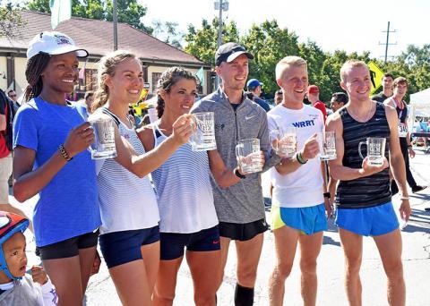Top runners received awards, from left, Jane Bareikis, Alyssa Schneider, Chirine Njeim, Alan Peterson, John Dewitt and Colin Mickow.