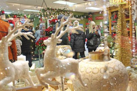 Shoppers fill local stores during the festival, including Homewood Florists on Martin Avenue.