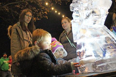 Jack McNicholas and Kelsey  Vanoffelen, both of Homewood, examine a recently completed ice sculpture.