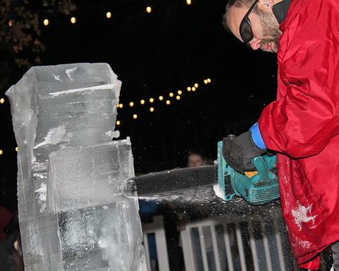 A craftsman with Nadeau's Ice Sculptures works on a sculpture.