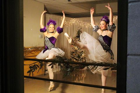 Dancers perform scenes from The Nutcracker in the window of the American Dance Center on Ridge Road.
