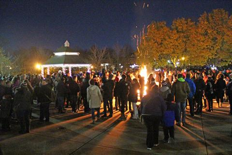 The crowd gathers around the bonfire in Irwin Park, awaiting the arrival of Santa Claus.