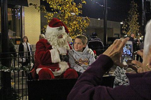 Jake Marks of Tinley Park visits with Santa on Martin Avenue.